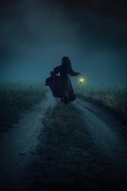 Natasza Fiedotjew Historical woman running with lantern at night in fog