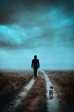 Natasza Fiedotjew SILHOUETTED MAN IN HAT ON COUNTRY LANE WITH DOG Men