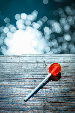 Natasza Fiedotjew LOLLIPOP ON WOODEN JETTY WITH SHIMMERING WATER Miscellaneous Objects