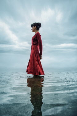 Natasza Fiedotjew Woman in red dress standing in lake