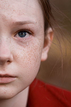 Elisabeth Ansley Close up of girl with freckles crying