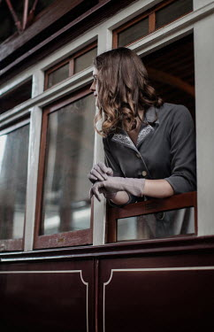 Nikaa Young woman leaning out train window
