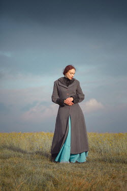Joanna Czogala Young woman in gray coat in field