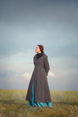 Joanna Czogala Young woman in gray coat in field
