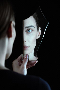 Magdalena Russocka woman's face reflected in piece of broken mirror