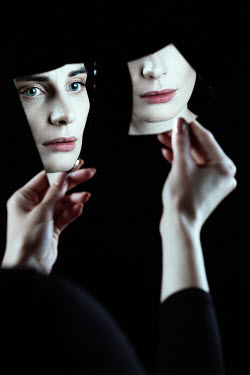 Magdalena Russocka woman's face reflected in pieces of broken mirror