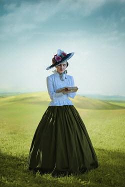 Ildiko Neer Victorian woman reading in meadow