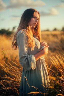 Klaudia Rataj Young woman in field at sunset