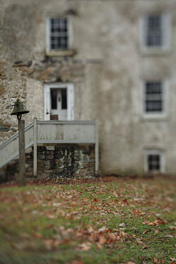 Lisa Bonowicz House and autumn leaves in grass