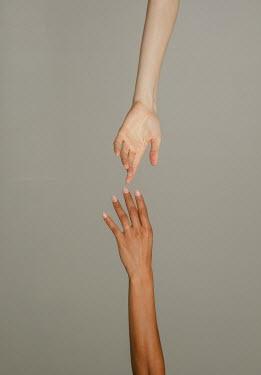 Nina Masic Hands of young women reaching