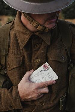 Matilda Delves Soldier holding postcards