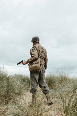 Matilda Delves Soldier standing on sand dunes