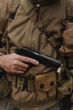 Matilda Delves Hand of soldier holding pistol