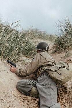 Matilda Delves Soldier on sand dunes