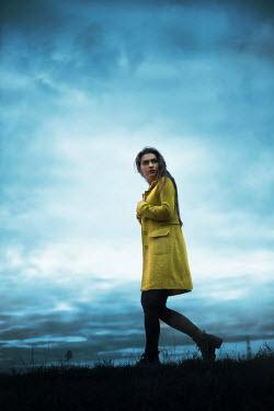 Ildiko Neer Scared woman walking in field