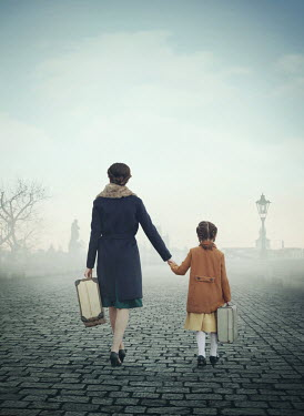 Mark Owen RETRO MOTHER DAUGHTER CARRYING SUITCASES ON FOGGY BRIDGE Children