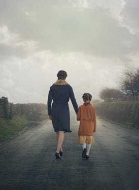 Mark Owen RETRO MOTHER AND DAUGHTER HOLDING HANDS IN COUNTRY ROAD Children