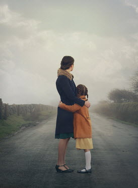 Mark Owen RETRO MOTHER AND DAUGHTER HUGGING IN COUNTRY ROAD Children
