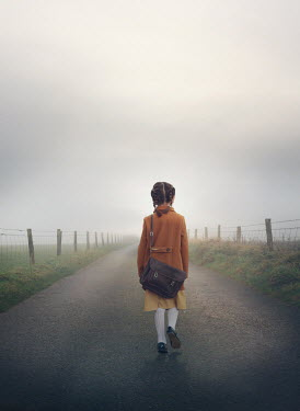 Mark Owen LITTLE GIRL WITH SATCHEL WALKING IN COUNTRY ROAD Children
