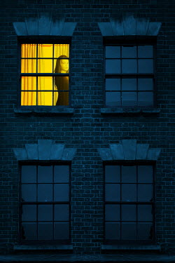 Magdalena Russocka female in window of old house at night