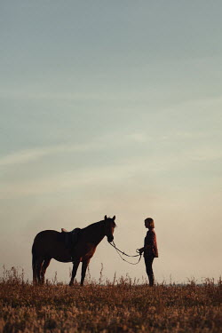 Magdalena Russocka teenage girl with horse in countryside