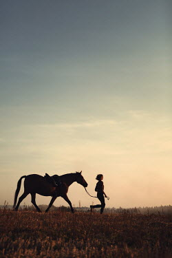 Magdalena Russocka teenage girl  with horse running in countryside