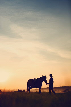 Magdalena Russocka teenage girl with horse standing in countryside