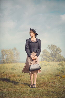 Joanna Czogala RETRO BRUNETTE WOMAN WITH HAT IN COUNTRYSIDE Women