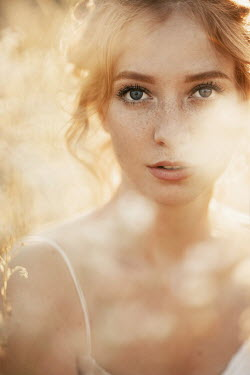 Nina Masic WOMAN WITH RED HAIR AND FRECKLES OUTDOORS IN SUNLIGHT Women
