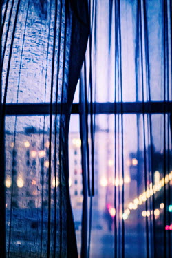 Elisabeth Ansley WINDOW AND CURTAINS WITH CITY LIGHTS AT DUSK Building Detail