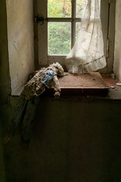 Elly De Vries DOLL LYING BY WINDOW OF OLD HOUSE Miscellaneous Objects