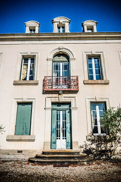 Elly De Vries EXTERIOR OF FRENCH MANSION WITH BLUE SKY Houses