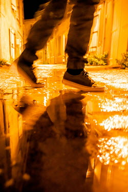 Elly De Vries MALE FEET WALKING BY PUDDLE IN STREET Men