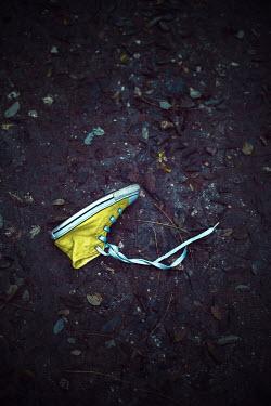 Ildiko Neer Child's yellow sneaker on ground