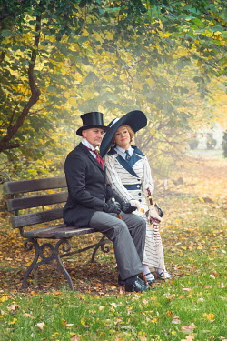 Joanna Czogala EDWARDIAN COUPLE SITTING IN AUTUMN COUNTRYSIDE Couples