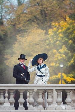 Joanna Czogala HAPPY EDWARDIAN COUPLE STANDING ON GRAND TERRACE Couples