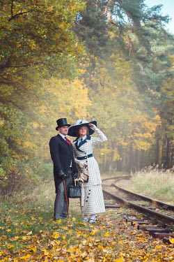 Joanna Czogala EDWARDIAN COUPLE BY RAILWAY IN AUTUMN COUNTRYSIDE Couples