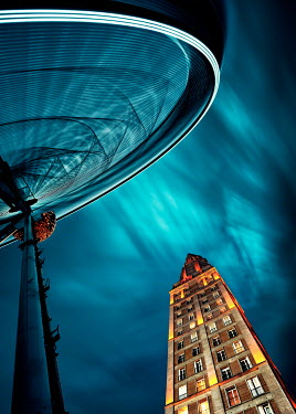 David Keochkerian SKYSCRAPER WITH GLOBE SCULPTURE AT NIGHT Miscellaneous Buildings