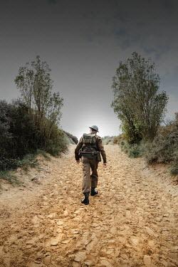Matilda Delves WW2 SOLDIER WALKING ON SANDY PATH Men