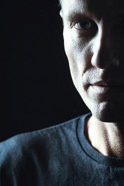 Magdalena Russocka close up of modern man staring in shadow