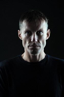 Magdalena Russocka modern man staring in shadow