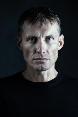 Magdalena Russocka close up of modern man staring inside