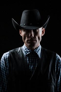 Magdalena Russocka close up of man in cowboy hat inside