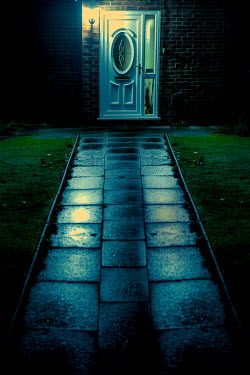 Lee Avison garden path leading to front door at night