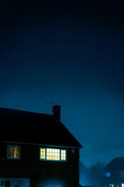 Lee Avison LIGHTS IN BEDROOM WINDOWS OF HOUSE AT NIGHT Houses