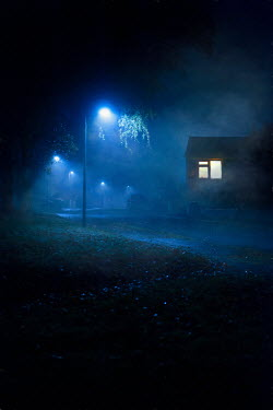 Lee Avison LIGHTS IN BEDROOM WINDOW OF HOUSE AND STREET AT NIGHT Houses