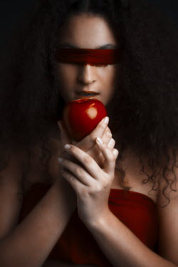 Robin Macmillan Young woman in red blindfold holding apple