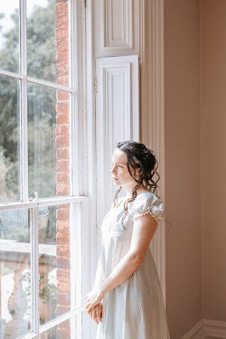 Shelley Richmond Young woman in Victorian dress by window