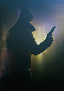 Ysbrand Cosijn Man holding pistol on street at night