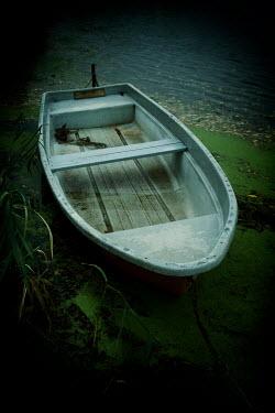 Carmen Spitznagel Boat on riverbank